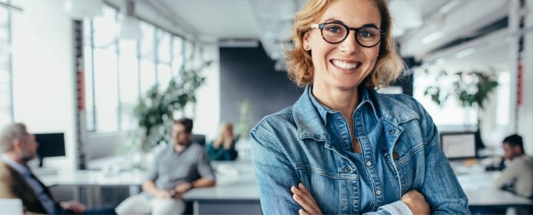 Woman in blue shirt and black glasses in microsoft consulting services firm